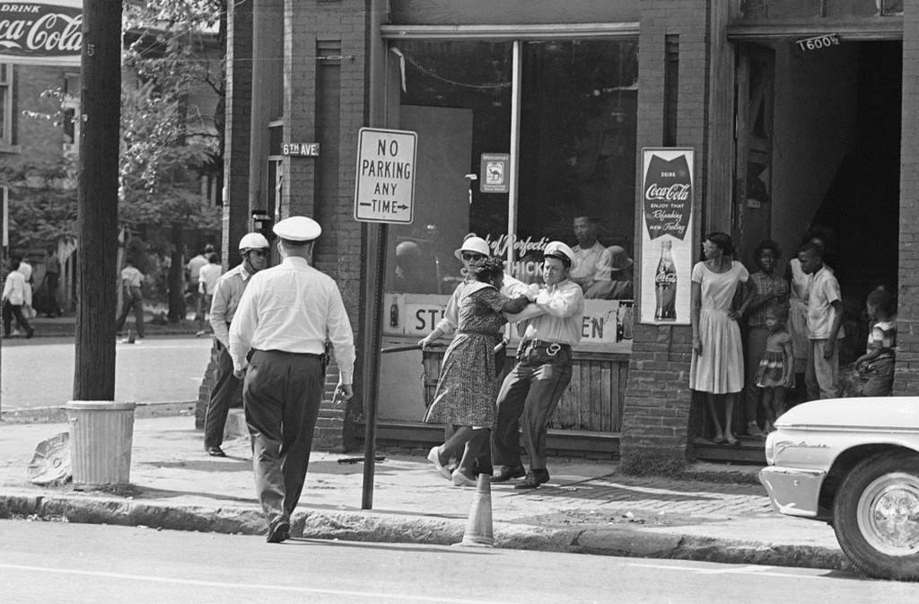 1963_black_woman_struggles_with_a_policeman_after_she_failed_to_move_on_during_black_protest_marches_birmingham_alabama.jpeg