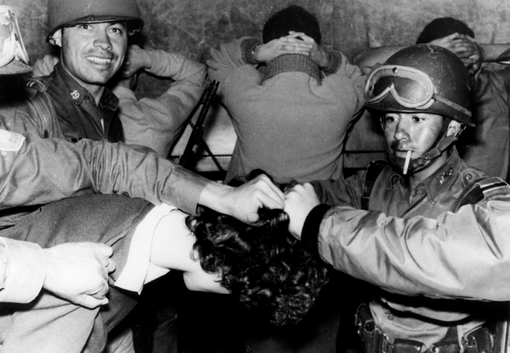 1968_soldiers_cut_a_student_s_hair_as_they_arrest_him_during_the_tlatelolco_massacre_in_mexico_city.jpeg