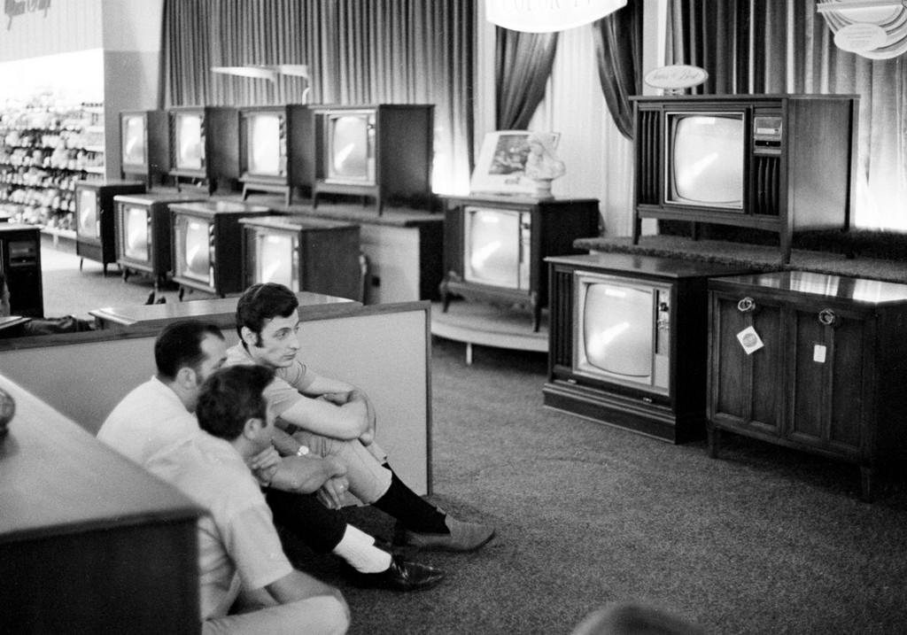 1969_julius_16_people_watch_the_apollo_11_saturn_v_rocket_launch_on_multiple_tv_s_at_a_sears_department_store_in_white_plains_n_y.jpeg