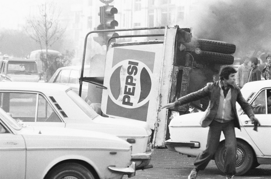 1978_an_overturned_truck_with_a_pepsi_logo_burns_during_islamic_revolution_in_tehran_iran.jpeg