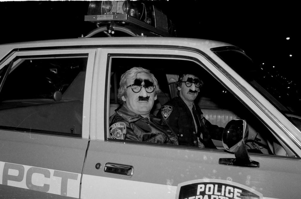 1980_oktober_31_policemen_from_an_upper_manhattan_precinct_dressed_in_matching_groucho_masks_gaze_from_the_window_of_their_car_on_halloween_night.jpeg