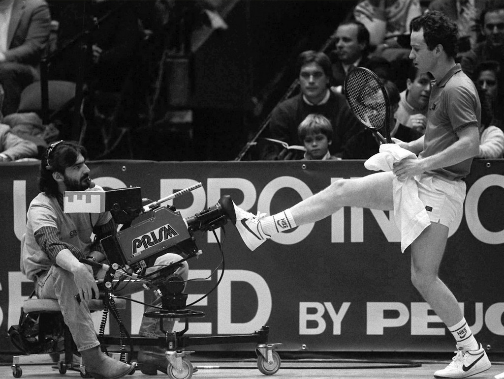 1985_john_mcenroe_kicks_back_a_television_camera_that_he_felt_was_crowding_him_on_the_court_during_the_finals_of_the_u_s_pro_indoor_tennis_championships_in_philadelphia_mcenroe_lost_his_match.jpeg