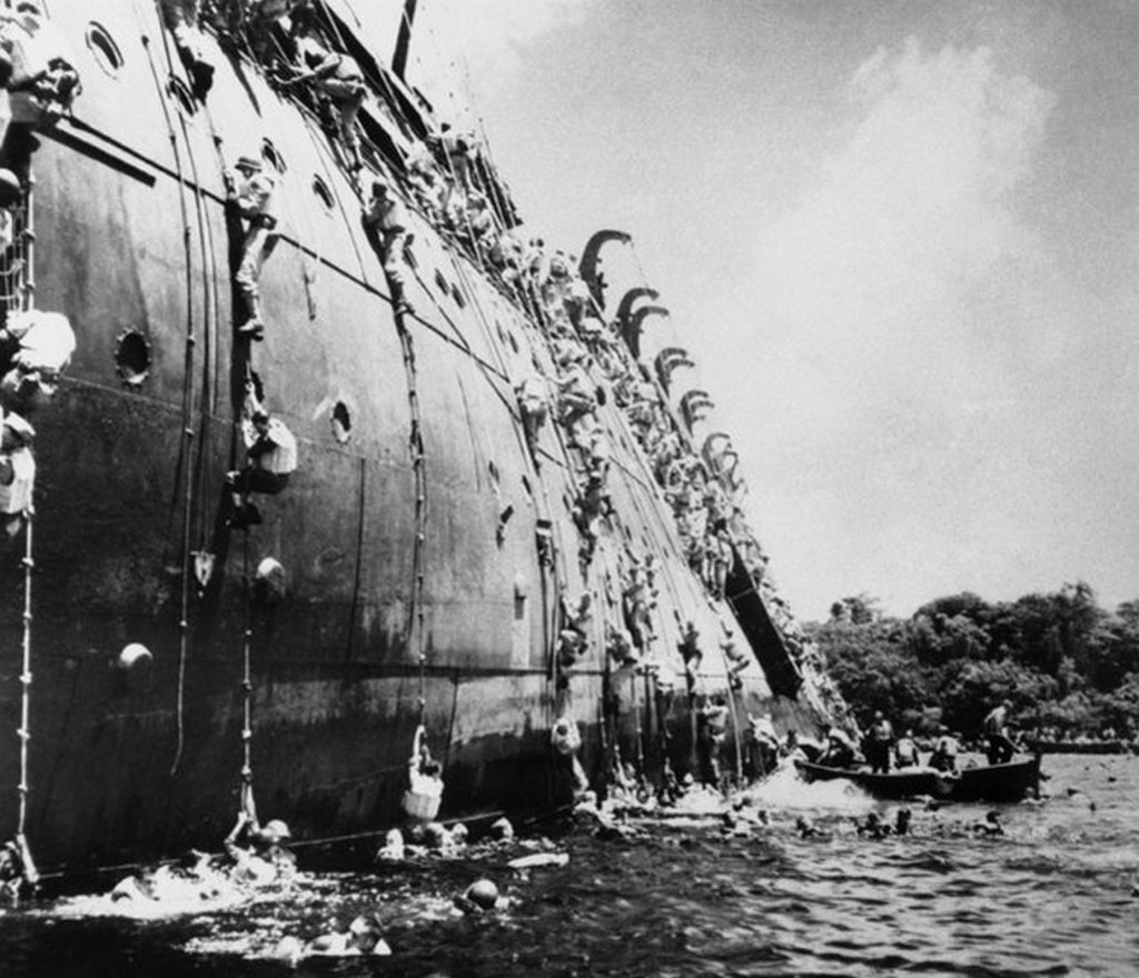 1943_marcius_21_abandon_the_ss_president_collidge_the_22_000-ton_troop_transport_which_struck_a_mine_in_a_harbour_on_espiritu_santo.jpeg