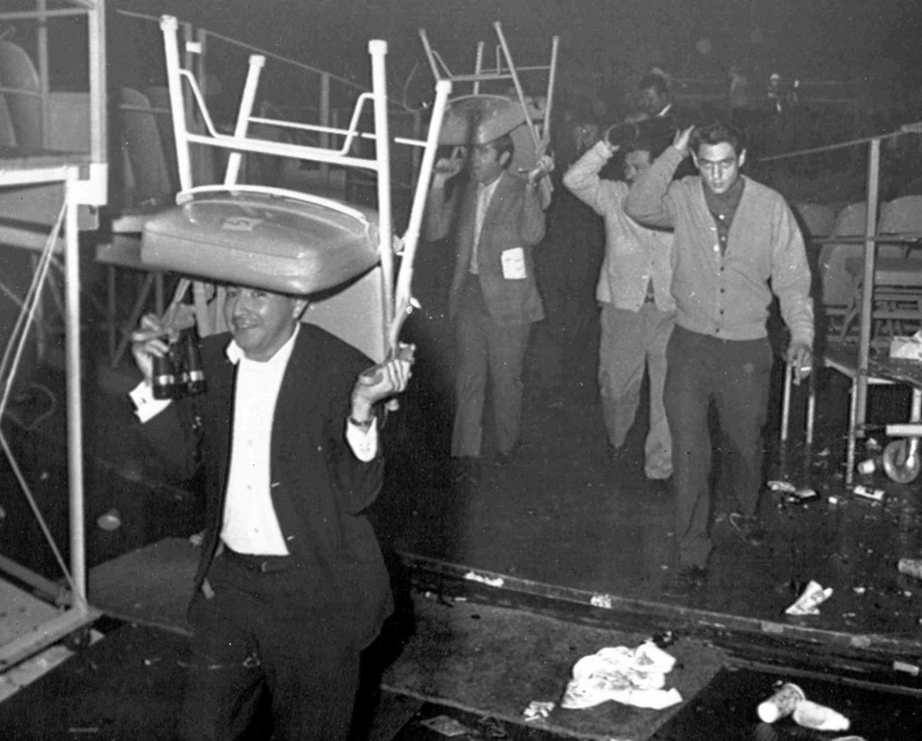 1968_fans_use_chairs_to_protect_their_heads_in_the_forum_in_los_angeles_usa_after_a_riot_broke_out_following_the_fight_between_lionel_rose_of_australia_and_chucho_castillo_of_mexico_boxers.jpeg