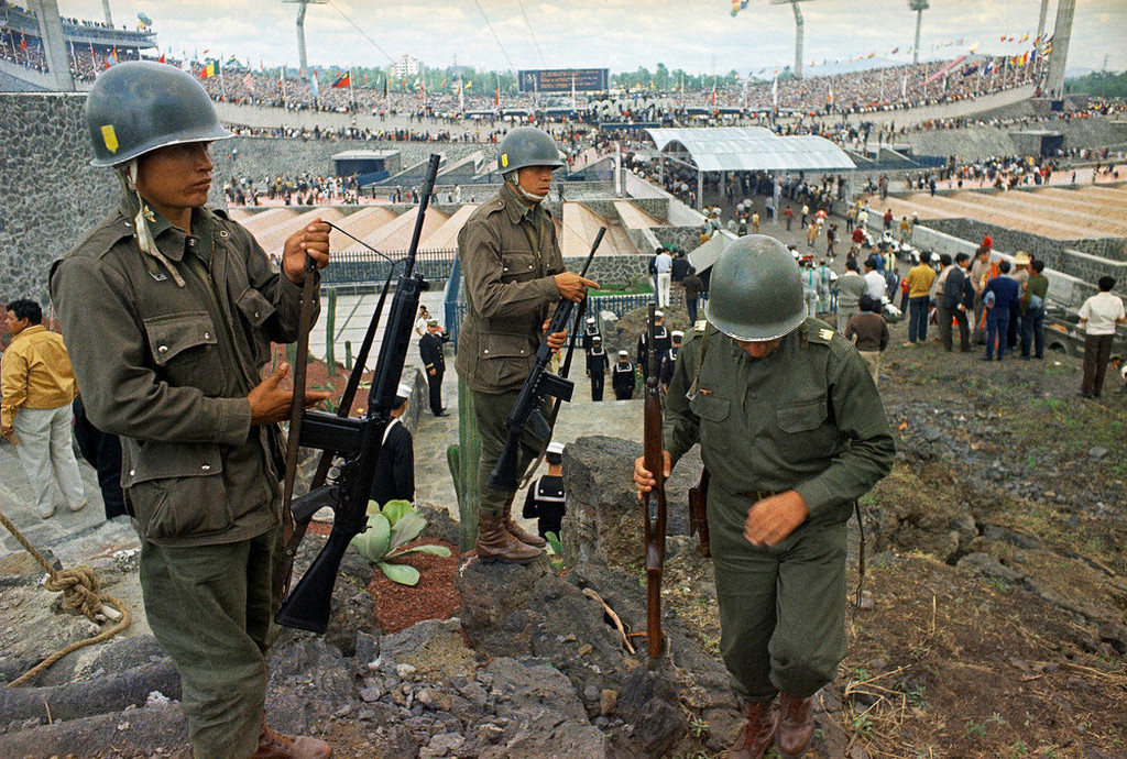 1968_oktober_12_soldiers_stand_guard_the_opening_ceremony_of_summer_olympics_in_mexico_city_one_week_after_soldiers_opened_fire_on_a_peaceful_demonstration_to_be_known_as_the_tlatelolco_massacre.jpeg