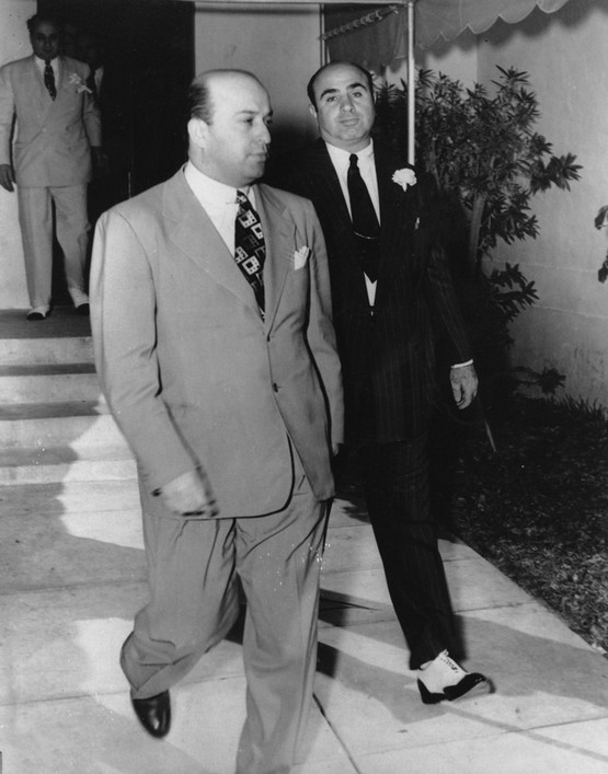 1941_december_30_al_capone_right_is_shown_in_one_of_his_last_public_appearances_as_he_and_his_unidentified_friend_leave_st_patrick_s_catholic_church_after_capone_s_son_s_wedding_in_miami.jpeg