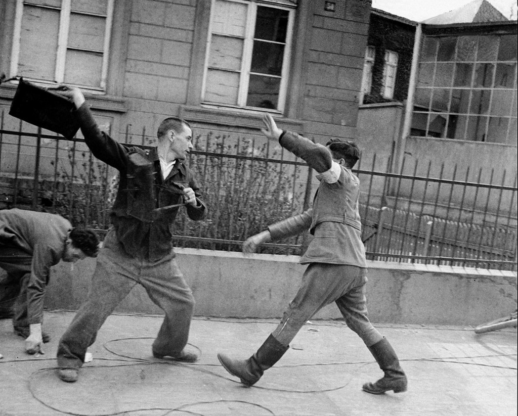 1945_aorilis_3_a_former_russian_slave_laborer_who_was_released_by_allies_after_3_years_of_forced_labor_in_a_german_factory_unleashes_his_anger_against_a_german_civilian_policeman_on_a_street_in_bonn_cr.jpg