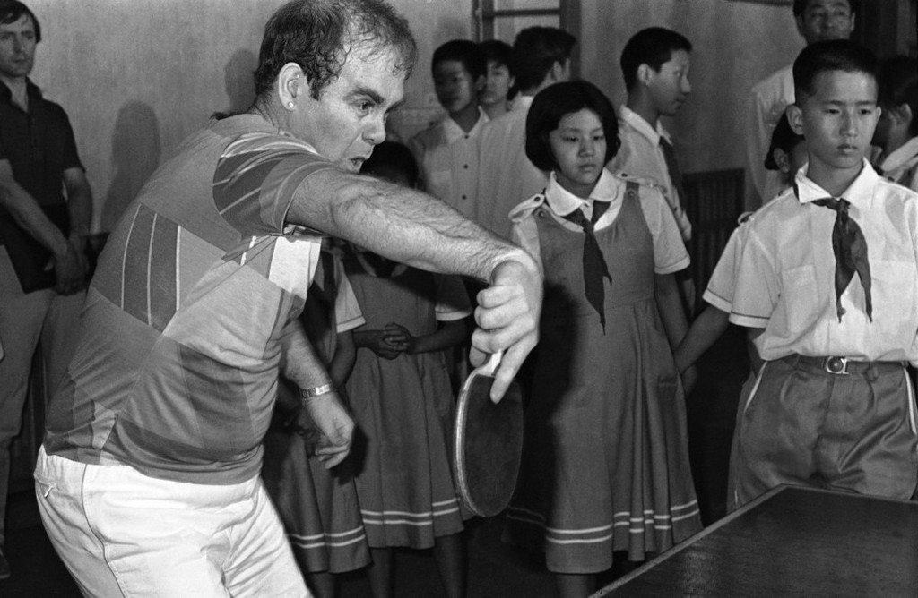 1983_british_rock_star_elton_john_returns_a_ball_during_a_ping_pong_match_with_a_13-year-old_li_dequn_in_peking_china.jpeg