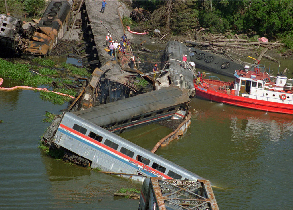 1993_wreckage_of_amtrak_train_north_of_mobile_ala_barge_hit_railroad_bridge_and_minutes_later_train_hit_the_bent_tracks_and_plunged_into_the_bay_killing_47_people_and_injuring_more_than_100.jpeg
