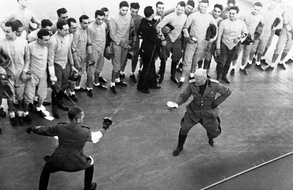 1936_benito_mussolini_right_fighting_a_fencing_duel_with_a_fascist_militia_officer_in_rome.jpeg