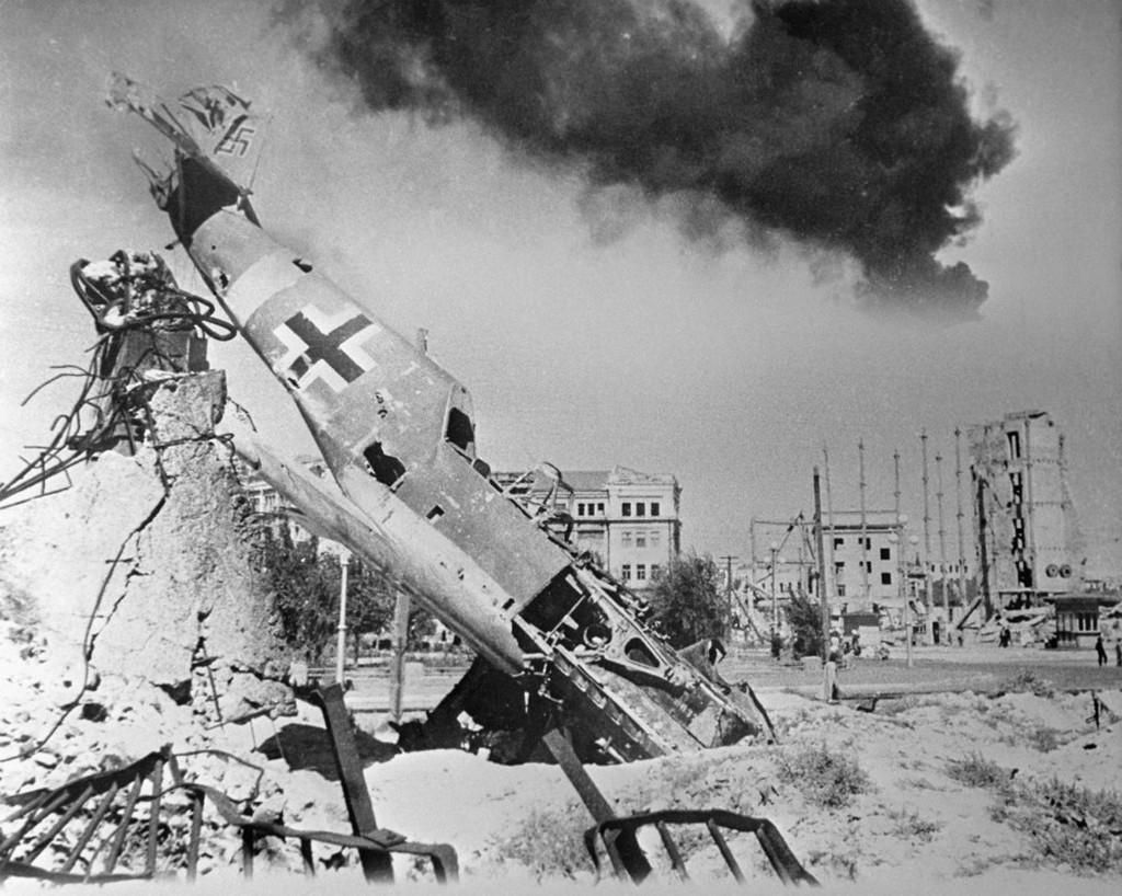 1942_a_downed_german_fighter_lies_amid_the_ruins_of_stalingrad.jpeg