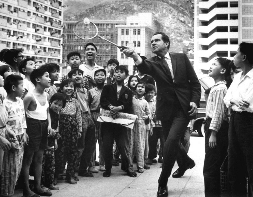 1964_aprilis_children_in_a_hong_kong_refugee_resettlement_area_watch_as_former_vice_president_richard_nixon_shows_them_his_badminton_service_nixon_visited_hong_kong.jpeg