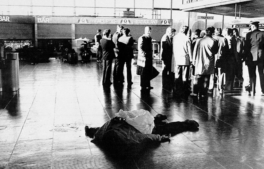 1985_victim_of_the_terrorist_attack_at_rome_s_leonardo_da_vinci_airport_december_27_1985_lies_on_the_floor_of_the_international_terminal_as_investigators_stand_nearby.jpeg