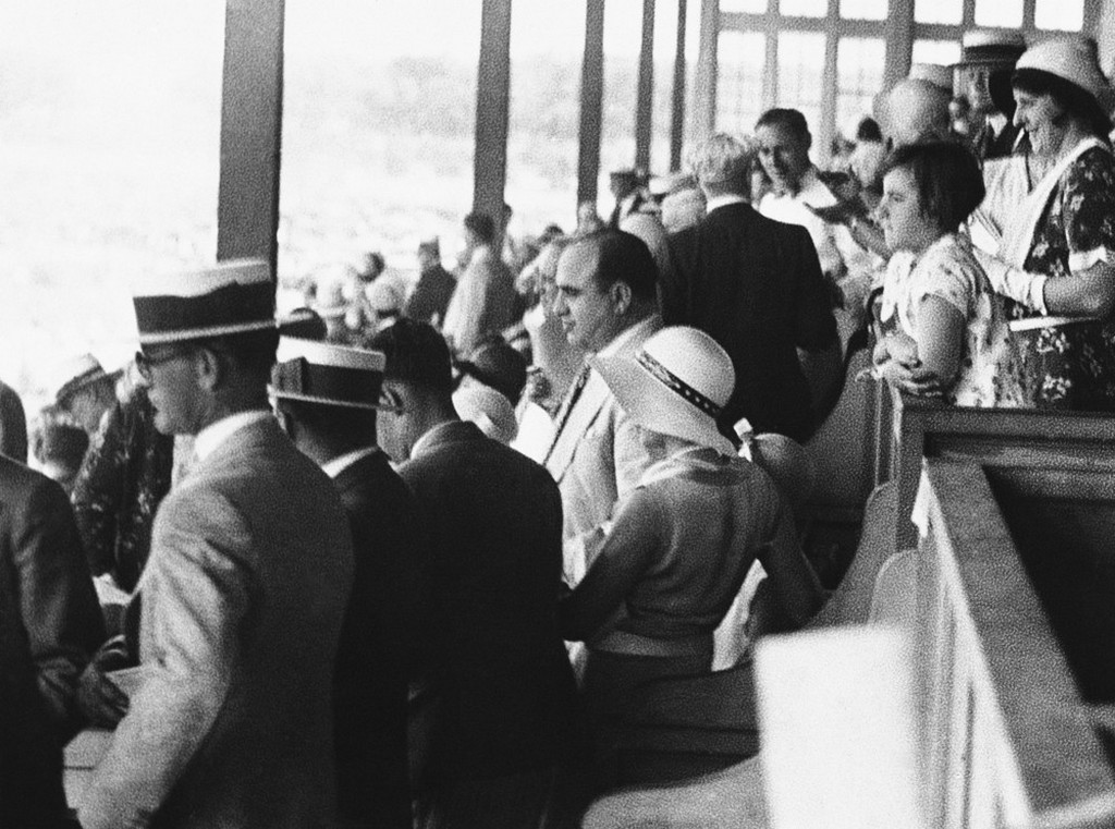1931_al_capone_who_must_vacate_his_gangland_throne_for_a_stretch_in_leavenworth_caused_quite_a_furor_among_the_40_000_persons_in_attendance_at_the_american_derby_washington_park_track_in_chicago.jpeg