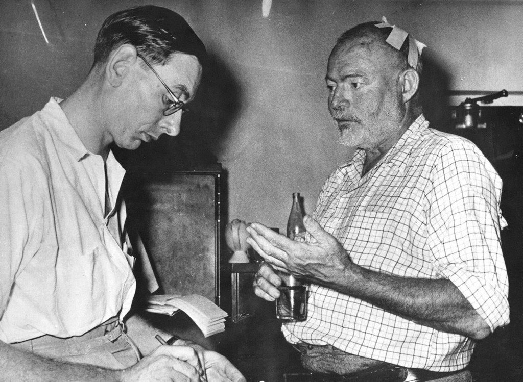 1954_ernest_hemingway_is_interviewed_by_a_newspaperman_at_entebbe_after_hemingway_and_his_wife_had_survived_two_plane_crashs_in_the_uganda_jungles_while_on_a_safari_tour_in_africa.jpeg