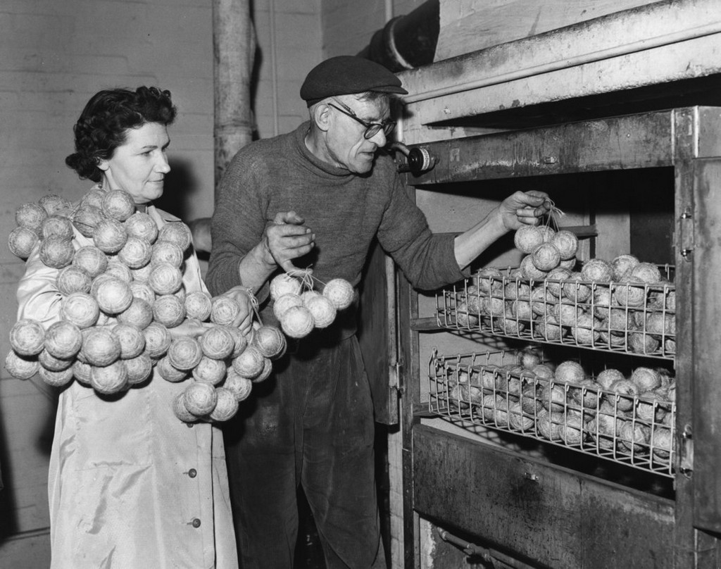 1960_workers_at_a_cricket_ball_factory_in_teston_kent_place_the_centres_of_the_balls_into_a_heated_oven_in_order_to_tighten_them.jpeg