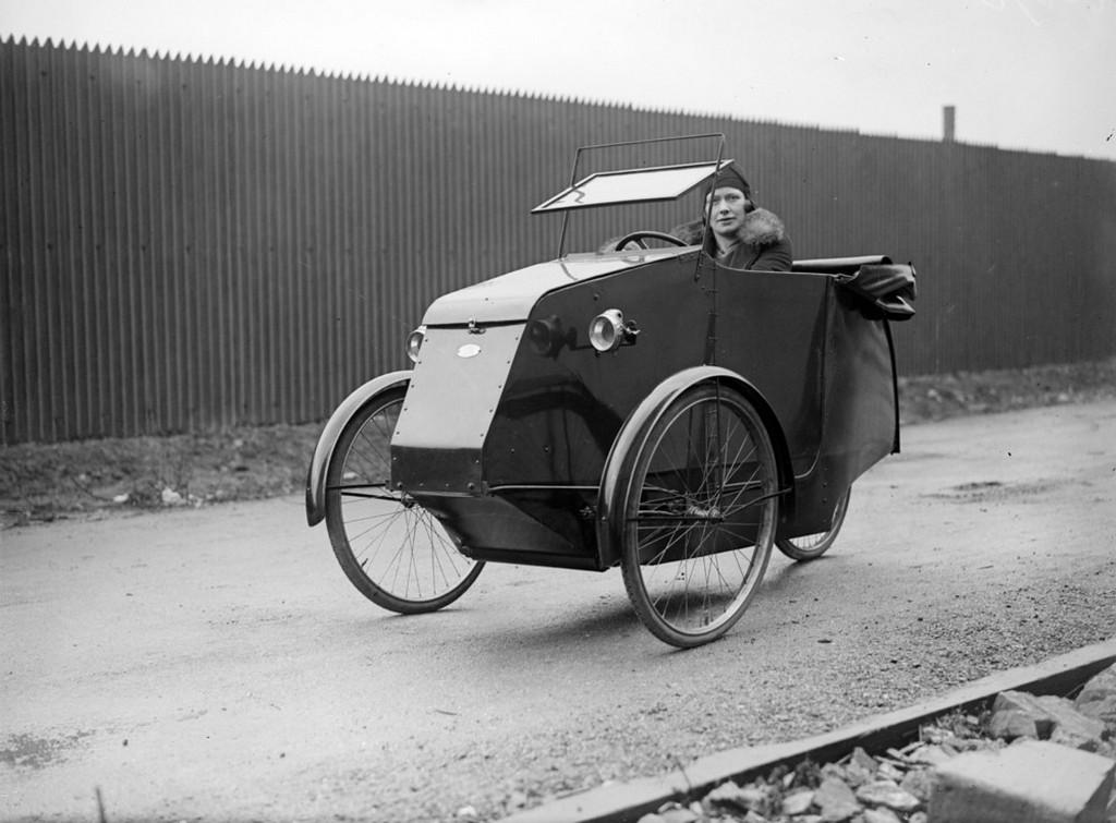 1930_a_three-wheeler_pedelux_cycle_car_at_park_royal_london.jpeg