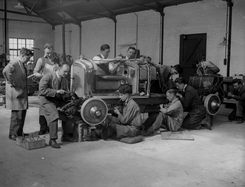 1930_mechanics_at_work_on_the_body_of_a_bentley_race_car_at_a_garage_in_welwyn_hertfordshire_united_kingdom.jpeg