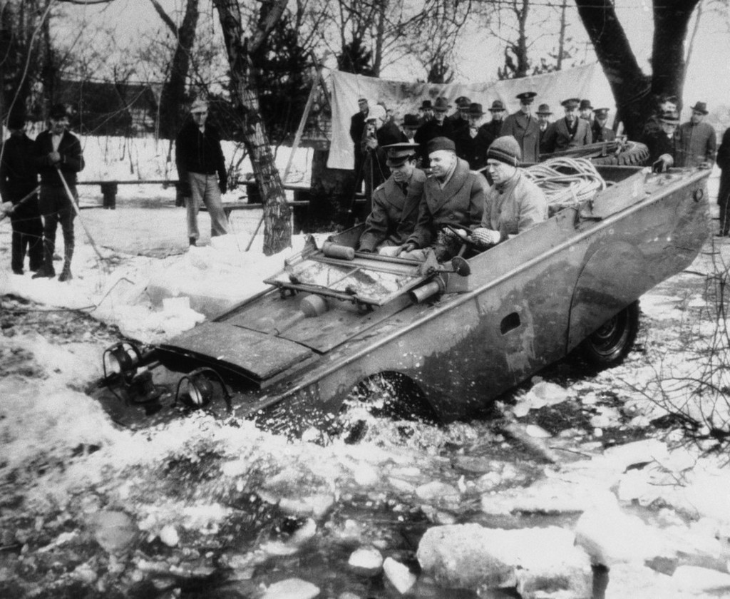 1943_marcius_one_of_the_new_quarter-ton_four-wheel_amphibian_jeeps_now_being_produced_for_u_s_fighting_forces_leaves_solid_ground_for_a_test-run_in_an_ice-clogged_stream_in_the_detroit_area.jpeg