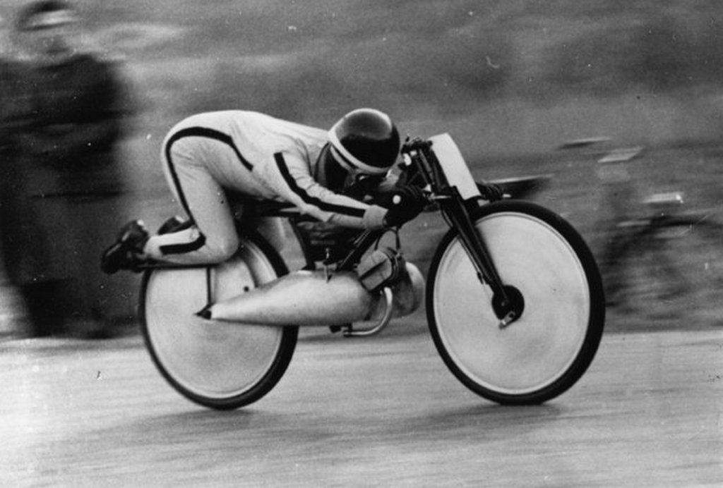 1949_marcius_italian_motorcyclist_raffaele_alberti_at_speed_on_his_strange-looking_75cc_moto_guzzi_during_his_successful_attempt_at_the_world_motorcycle_speed_record_in_schweiz.jpeg