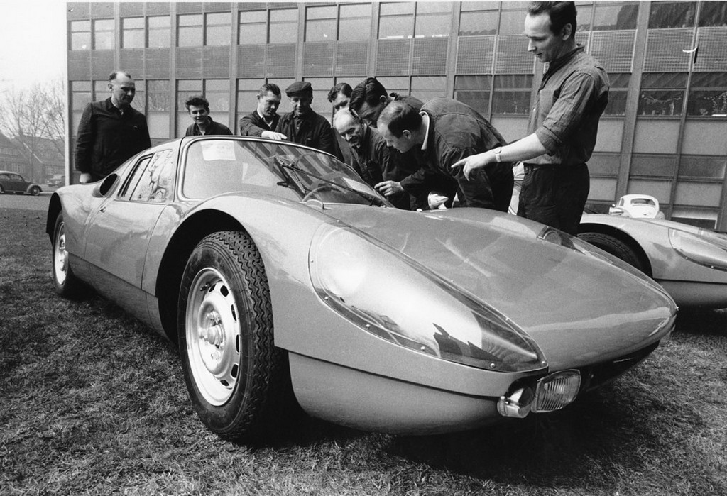 1964_a_group_of_mechanics_examine_the_new_porsche_gran_turismo_type_904_designed_with_a_boxer-engine_and_a_polyester_plastic_body_in_ludwigshafen_germany.jpeg