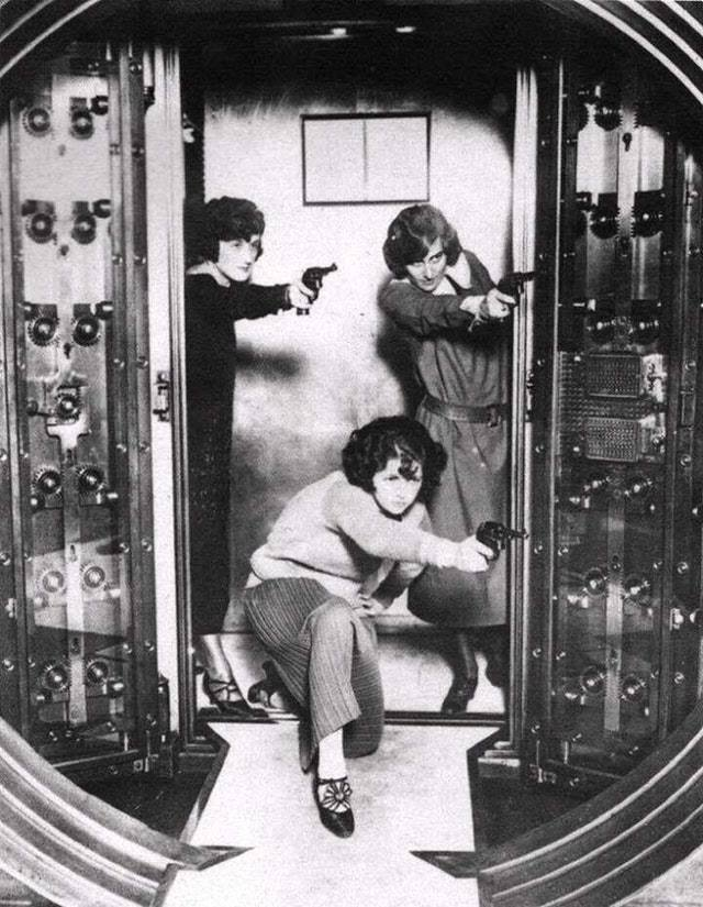 1924_three_employees_of_the_cleveland_trust_bank_co_being_trained_to_defend_the_bank_vault_in_the_company_s_office.jpg