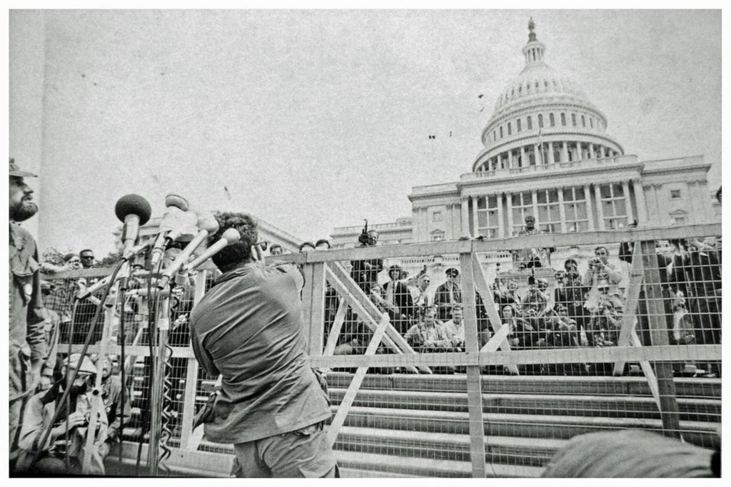 1971_a_vietnam_veteran_throws_his_war_medal_at_the_capitol_building_in_protest_of_the_war.jpg