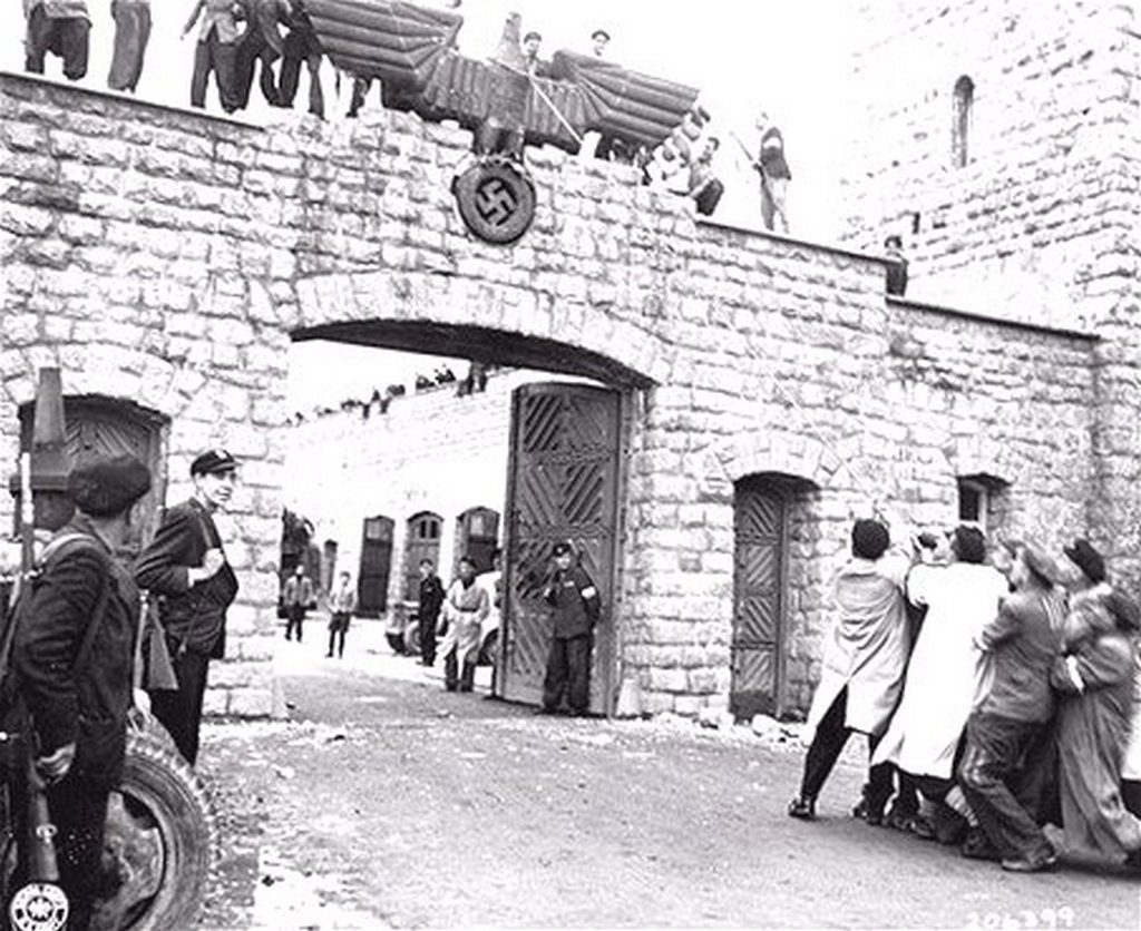 1945_majus_survivors_eagerly_pull_down_the_nazi_eagle_over_entrance_to_the_ss_compound_at_mauthausen_concentration_camp_in_austria.jpg