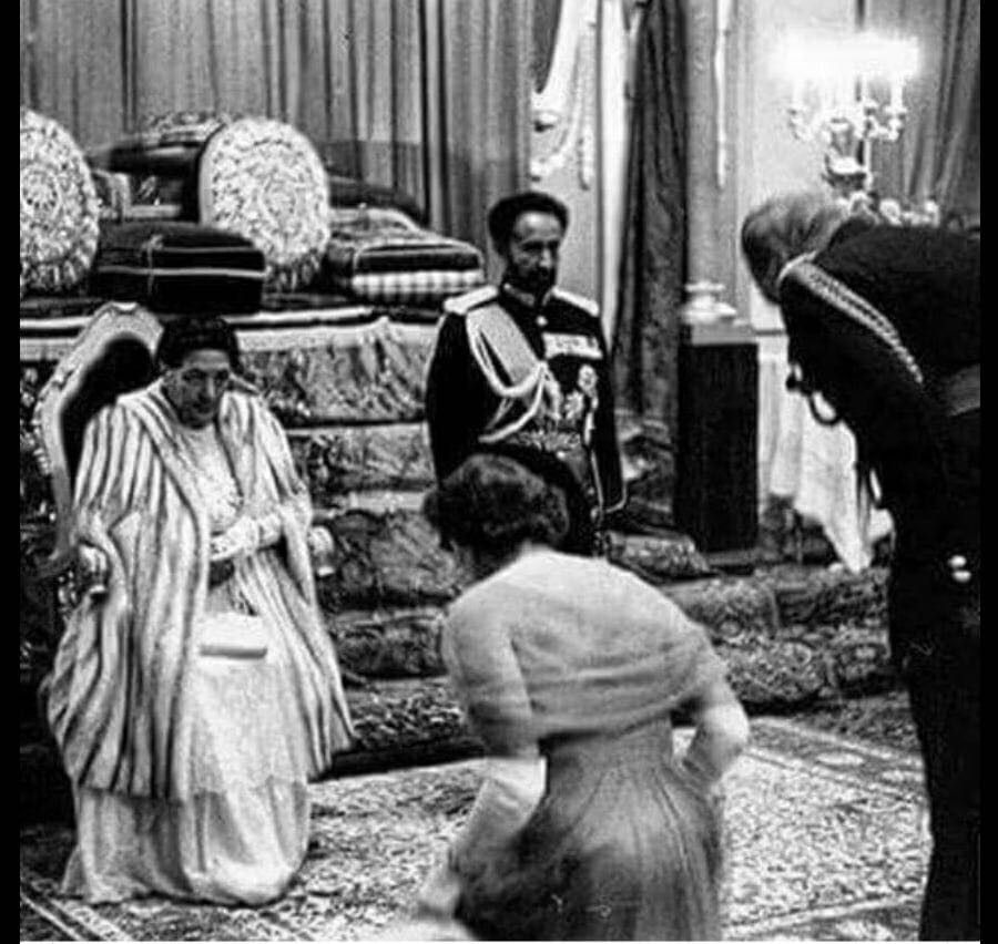 1954_queen_elizabeth_and_prince_phillip_bowing_before_haille_selassie.jpg