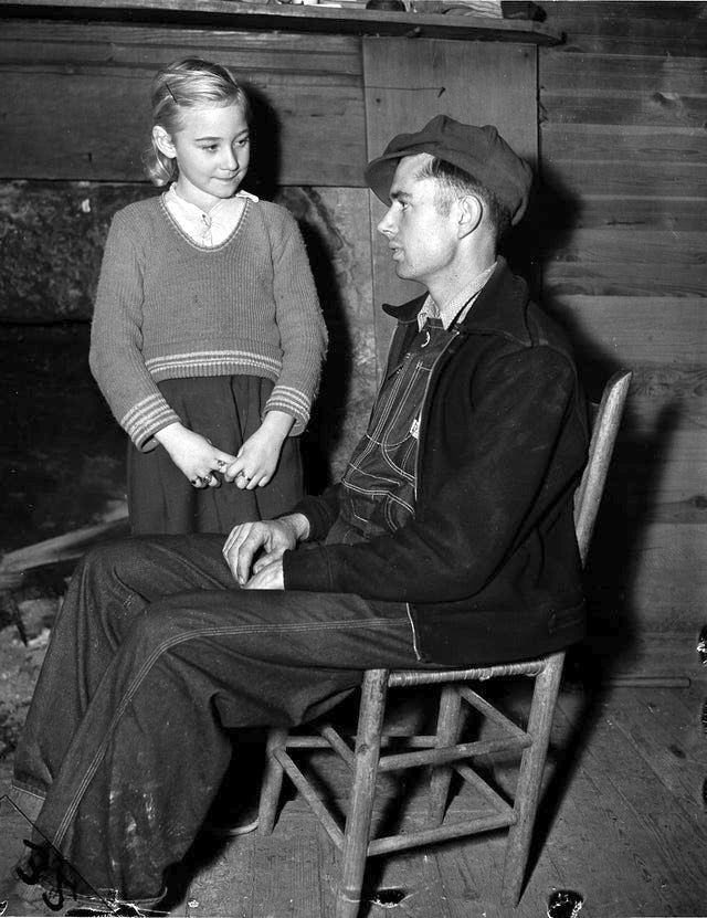 1937_9-year_old_eunice_winstead_johns_and_her_husband_charlie_johns_22_at_their_home_sneedville_tennessee.jpg