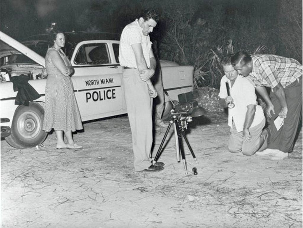 1954_detectives_look_over_evidence_in_north_miami_florida.jpg