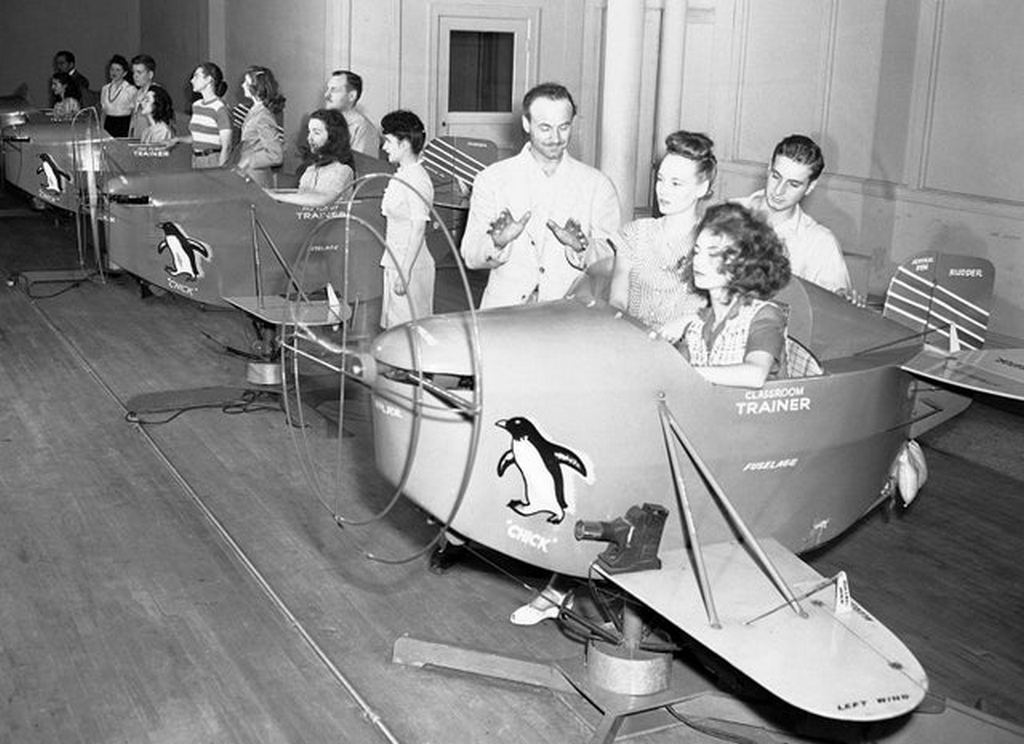1945_albert_h_luke_center_an_instructor_at_the_sheil_school_advises_a_student_as_she_operates_the_controls_of_a_preflight_trainer_device_chicago_illinois.jpg