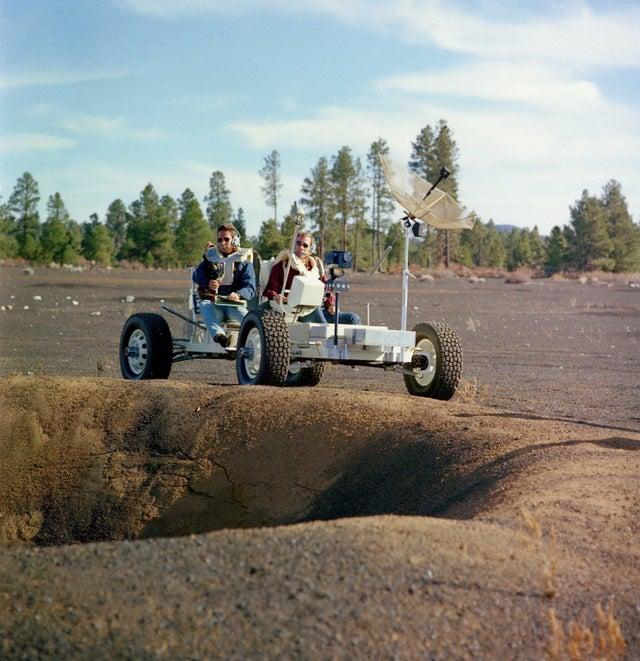 1970_cca_apollo_15_astronauts_jim_irwin_l_and_dave_scott_r_drive_a_lunar_roving_vehicle_lrv_simulator_to_participate_in_geology_training_at_the_cinder_lake_crater_field_in_arizona.jpg
