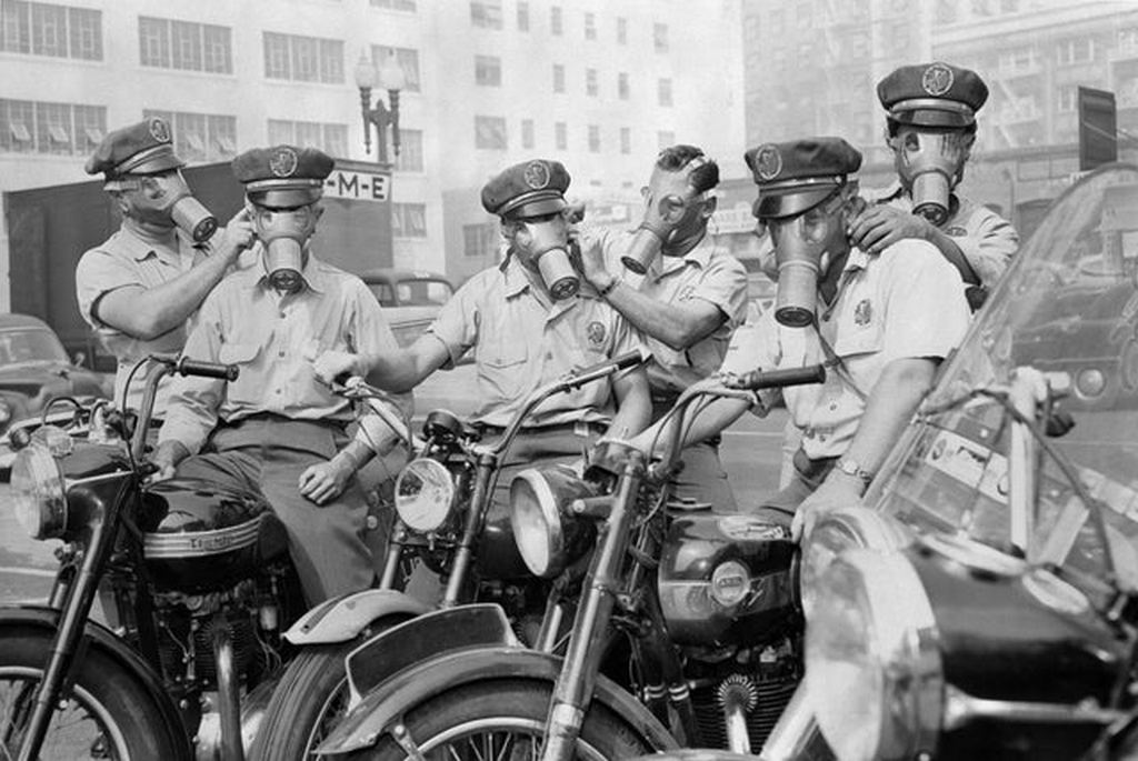1955_motorcycle_messengers_equipped_with_gas_masks_for_work_in_a_city_heavily_polluted_with_smog_usa_los_angeles.jpg