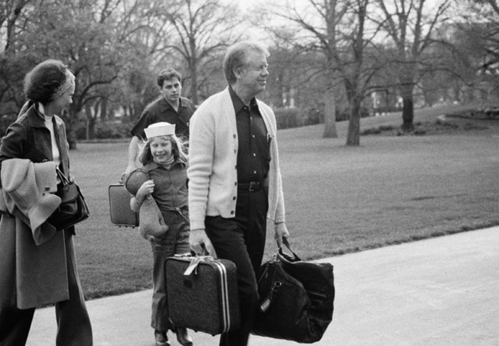 1977_pres_jimmy_carter_right_is_followed_by_his_daughter_amy_carter_center_as_they_return_to_the_white_house_washington_after_a_weekend_at_camp_david.jpeg
