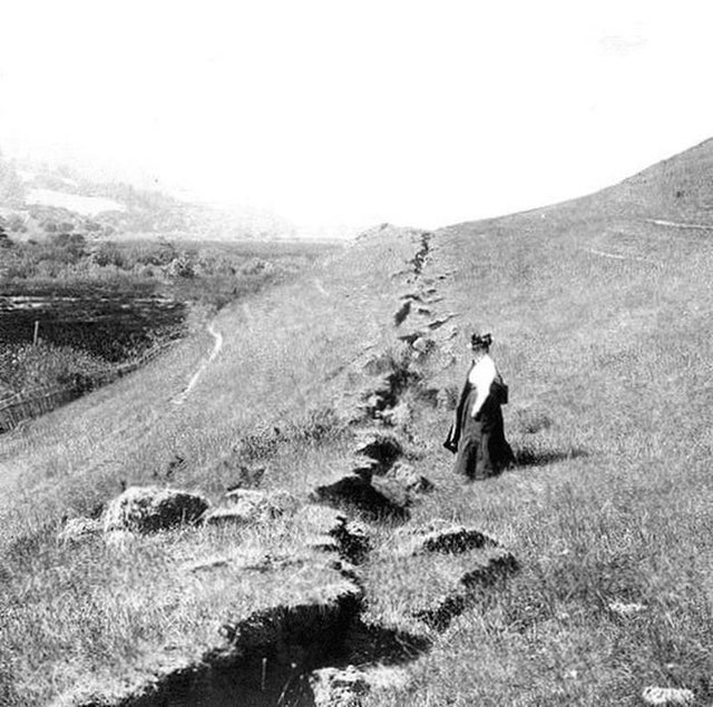 1906_woman_observing_the_massive_split_in_the_earth_from_the_7_8_magnitude_earthquake_along_the_san_andreas_fault.jpg