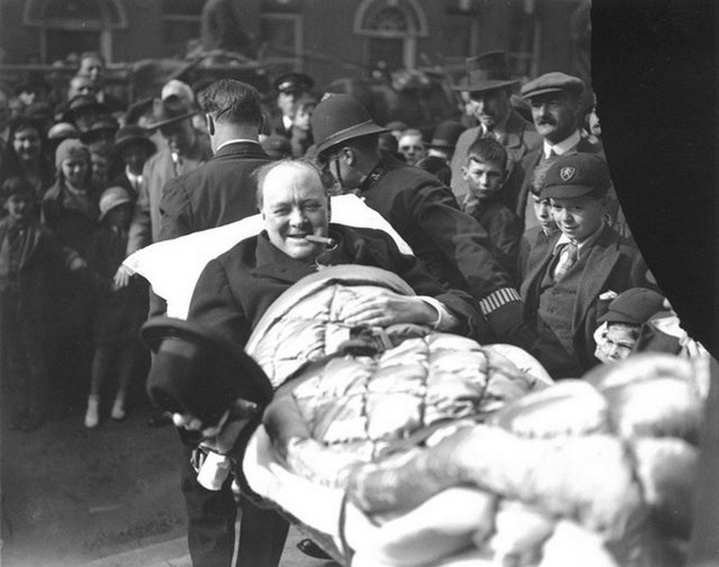 1931_winston_churchill_is_carried_from_a_nursing_home_following_being_struck_by_a_car_in_new_york_city_he_was_crossing_fifth_avenue.jpg