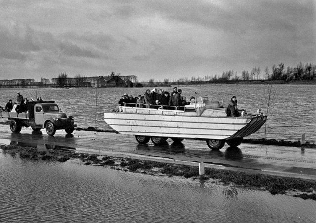 1953_a_loaded_amphibian_tows_a_broken_down_lorry_also_loaded_with_refugees_during_rescue_operations_on_the_devastated_zuid_beveland_holland_february_6.jpg