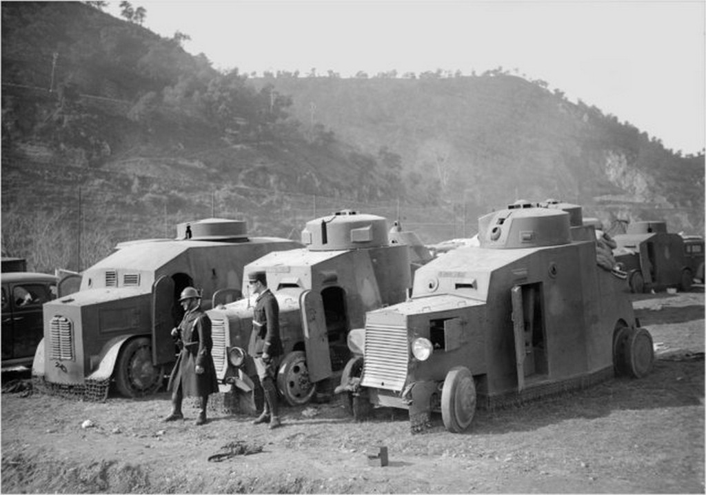 1939_french_soldier_and_policeman_standing_guard_next_to_armored_vehicles_of_the_spanish_republican_army_disarmed_in_the_pyrenees_after_the_republicans_lost_the_spanish_civil_war_against_franco.jpg