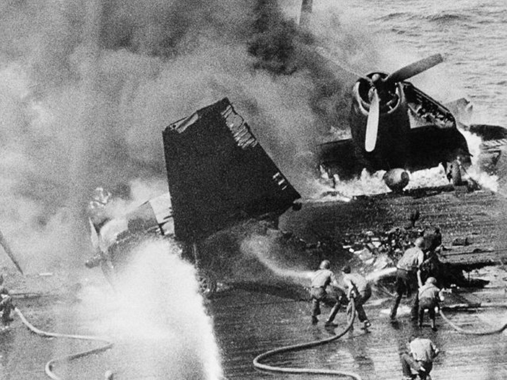 1945_firefighting_crews_of_an_unnamed_u_s_carrier_battle_flames_in_two_planes_which_were_hit_by_japanese_bombs_in_the_philippines_january_4_1945_while_on_the_flight_deck_of_the_flat_top.jpg
