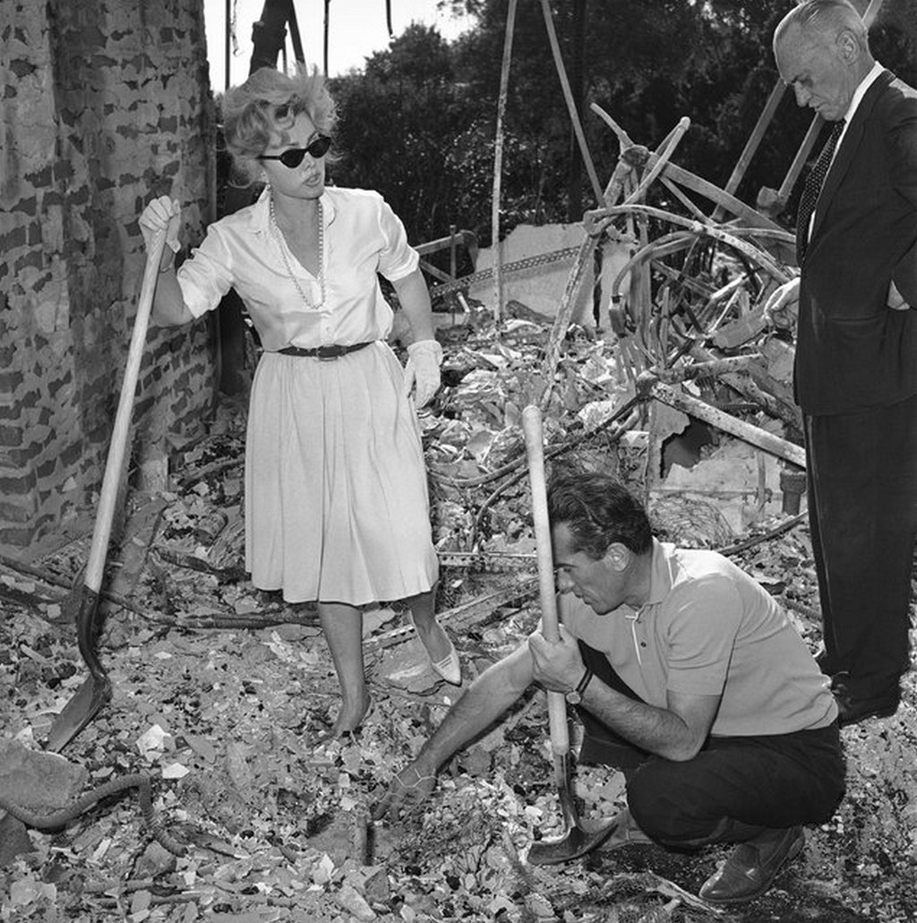 1961_zsa_zsa_gabor_aided_by_a_friend_robert_straile_digs_through_the_ashes_of_her_275000_bel-air_home_in_los_angeles_nearly_500_homes_burned_in_the_area_during_the_infamous_bel_air_fire.jpg