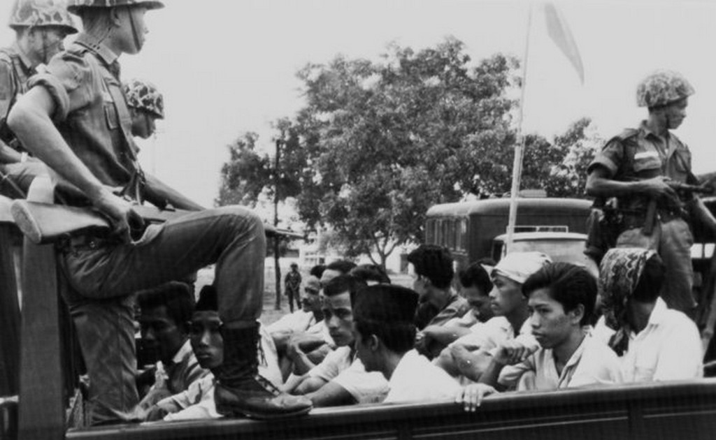1965_members_of_the_indonesian_communist_party_pemuda_rakjat_are_watched_by_soldiers_as_they_are_taken_to_prison_in_jakarta_following_a_crackdown_on_communists_after_an_abortive_coup_against_president_sukarno.jpg