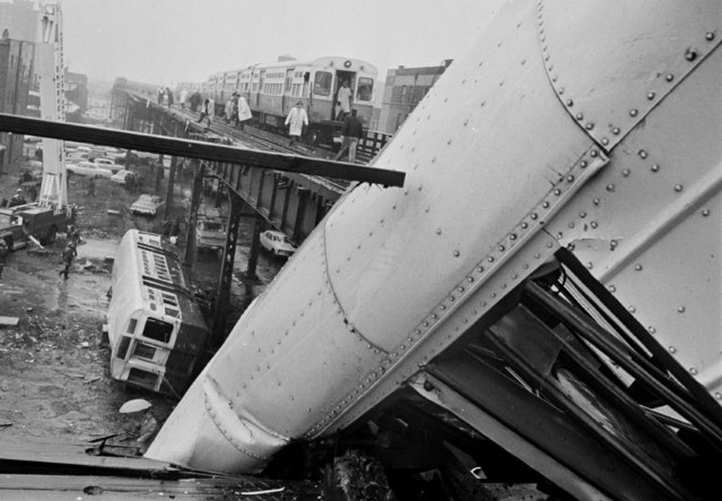 1966_rescue_workers_and_a_fire_department_snorkel_work_on_the_wreckage_of_an_elevated_train_which_derailed_in_chicago_25_injured.jpg