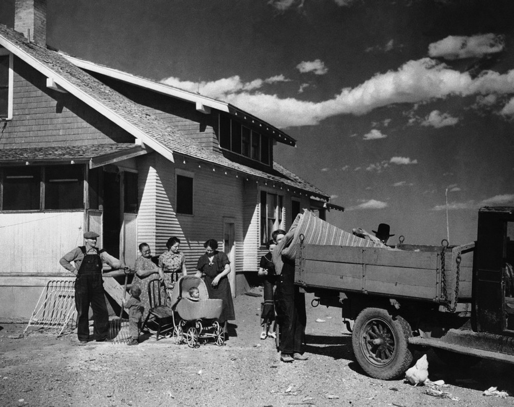 1937_from_ne_colorado_to_southwestern_colorado_irrigated_lands_more_than_100_families_will_be_moved_from_dust_bowl_lands_to_the_federal_project_hungarian_origin_kovach_family_load_household_goods_to_truck.jpeg