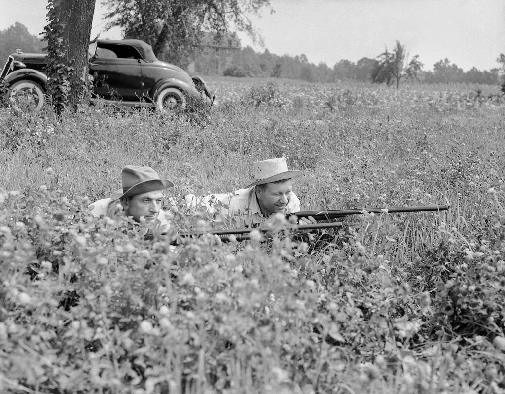 1942_two_members_of_the_maryland_minute_men_a_civilian_defense_organization_hold_their_rifles_as_they_lie_low_in_a_southern_maryland_hay_field_during_a_search_for_traces_of_parachutists.jpeg