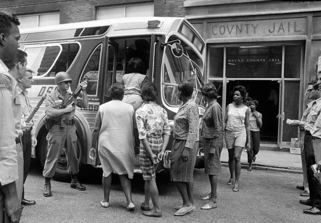 1967_female_prisoners_arrested_during_the_rioting_in_detroit_board_a_bus_at_wayne_county_jail_watched_by_national_guardsmen_for_transfer_to_eloise_a_detention_home_for_women.jpeg