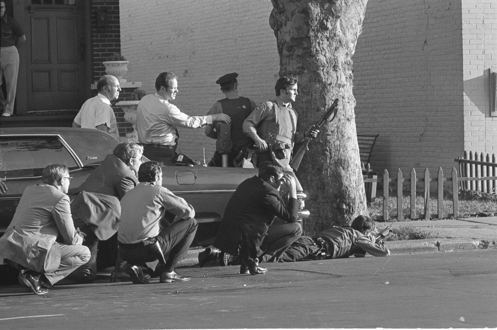 1972_nyc_police_ready_with_arms_behind_a_tree_as_two_gunmen_who_described_themselves_as_homosexuals_hold_eight_hostages_inside_the_bank_in_brooklyn.jpg