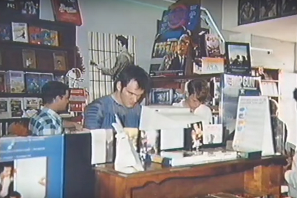 1987_quentin_tarantino_working_at_a_video_rental_store_in_california.png