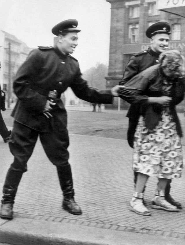 1945_soviet_soldiers_openly_sexually_harass_a_german_woman_in_leipzig.jpg