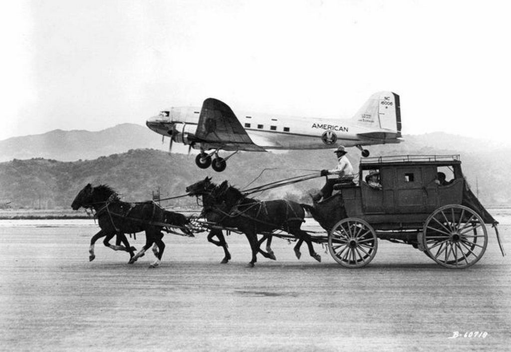 1949_an_american_airlines_dc-3_plane_flying_past_a_stagecoach.jpg